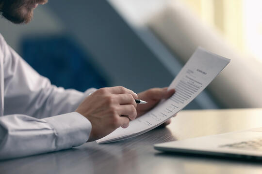 Man reading a document