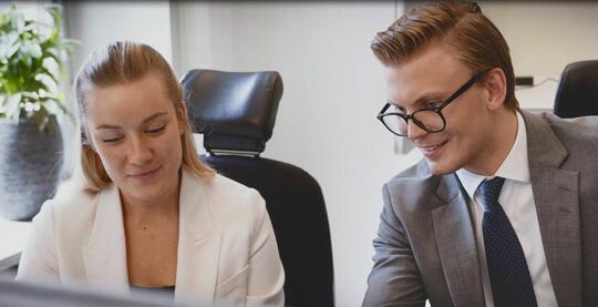 Colleagues discussing prospective client
