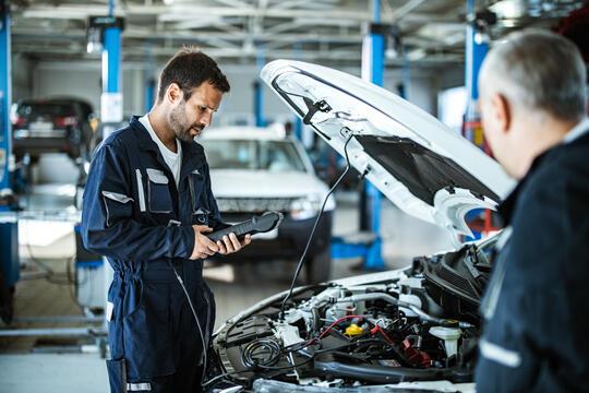 Man undertaking vehicle inspection